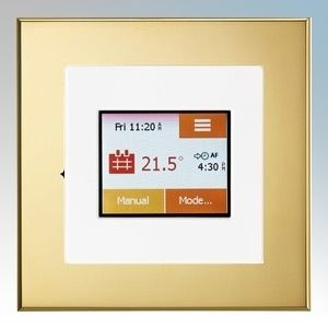 White / brass colour touchscreen thermostat